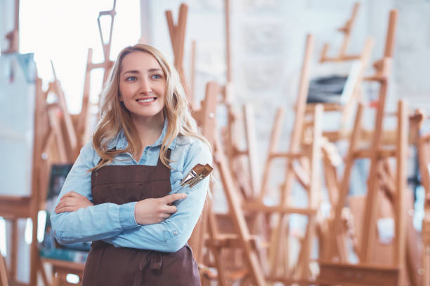 Smiling woman with a brush stock photo