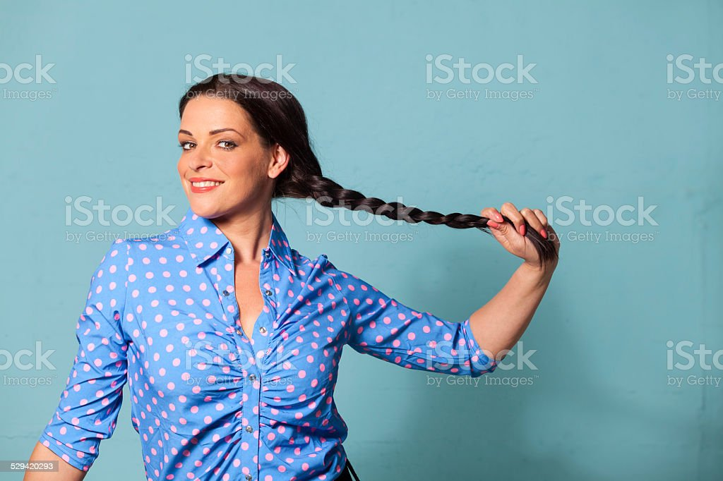 smiling woman with a pigtail stock photo