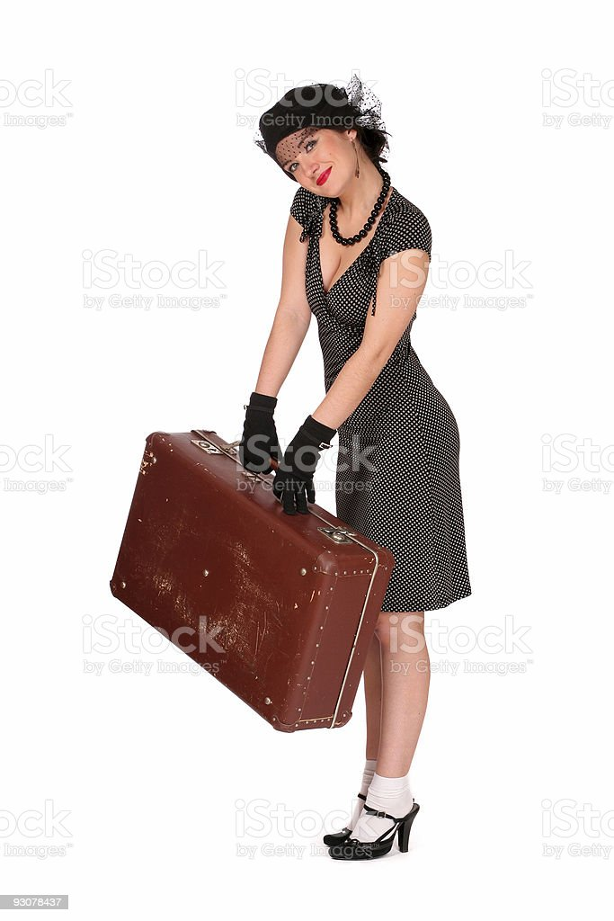smiling woman with a suitcase royalty-free stock photo