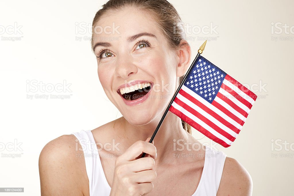 Smiling Woman With American flag royalty-free stock photo