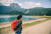 istock Smiling woman with backpack 918975088