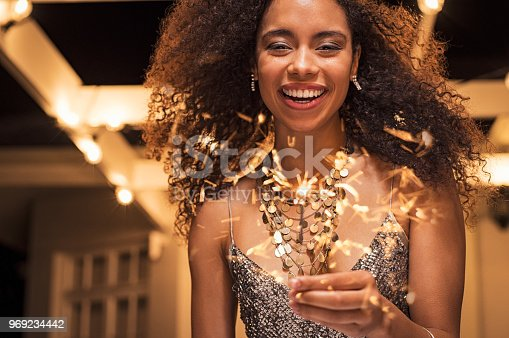 istock Smiling woman with bengal light 969234442
