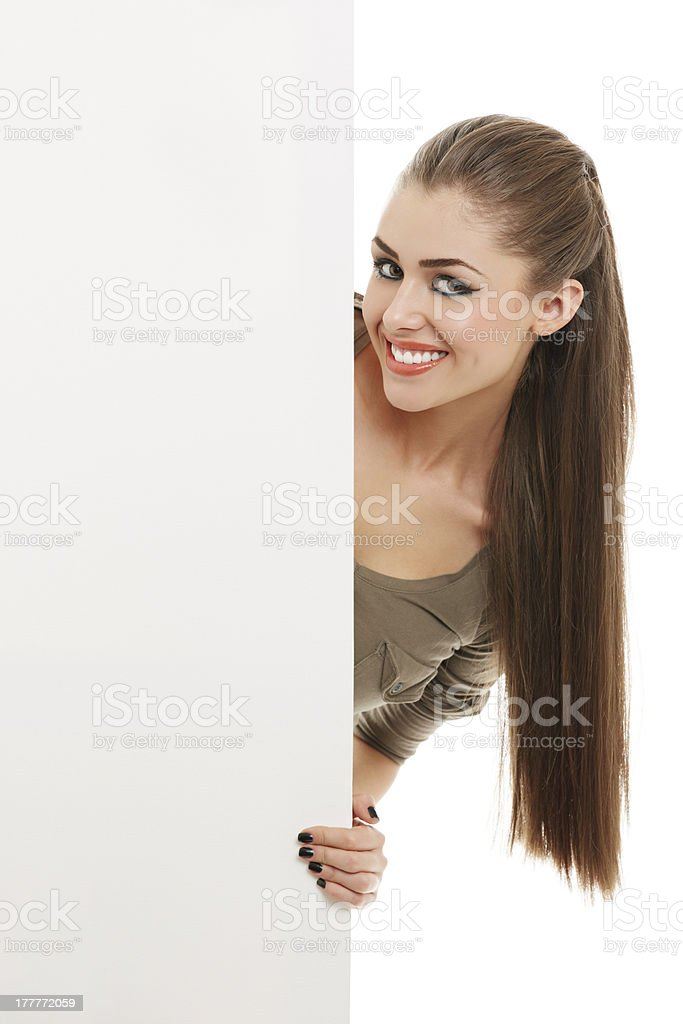 Smiling woman with blank board sign royalty-free stock photo