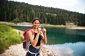 istock Smiling woman with camera. 858867934