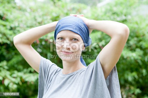 Beautiful young woman with cancer smiling