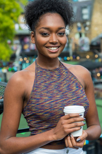 Smiling Woman with Coffee in Camden Lock area, London, UK stock photo