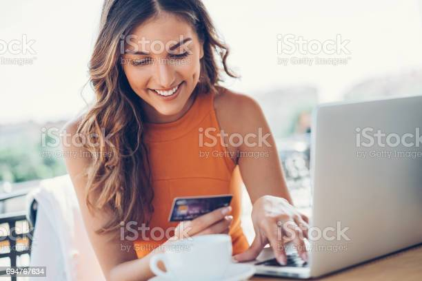 Smiling woman with credit card and laptop picture id694767634?b=1&k=6&m=694767634&s=612x612&h=g4bzgstfg0ngjlz8cvt1ff0c5cjldtwmkqzmfvmx5wy=