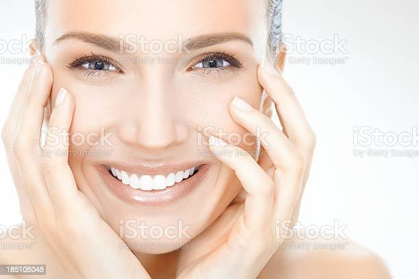 Smiling Woman With Face In Hands Stock Photo - Download Image Now