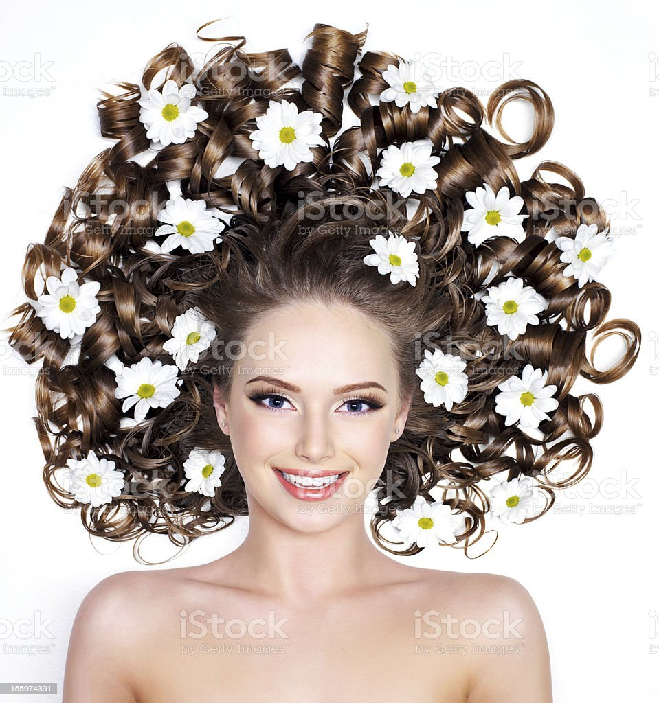 Smiling woman with flowers in hair royalty-free stock photo