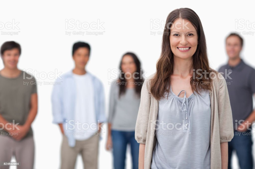 Smiling woman with friends standing behind her stock photo