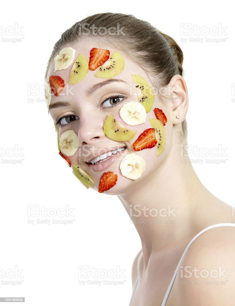 Smiling woman with fruit mask royalty-free stock photo