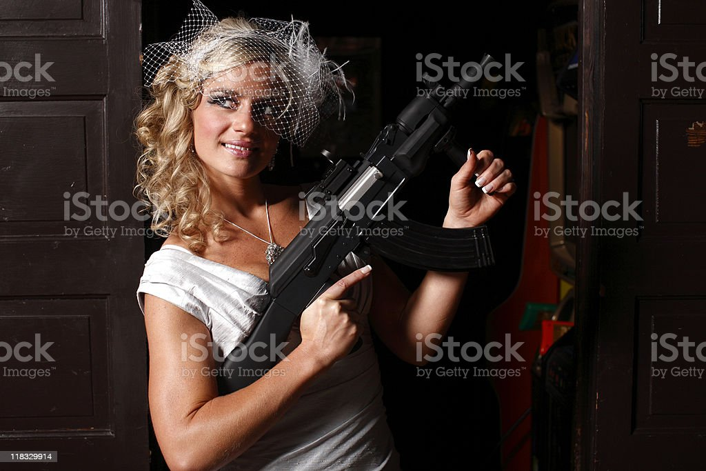 Smiling woman with gun royalty-free stock photo