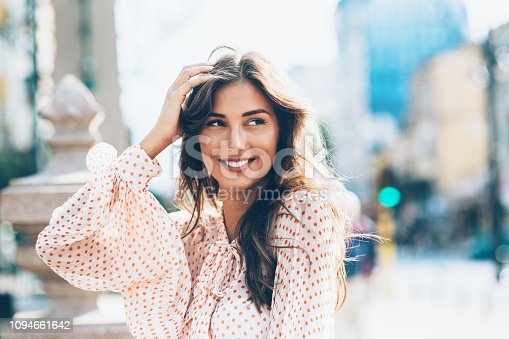 Beautiful Smiling woman with hands in hair