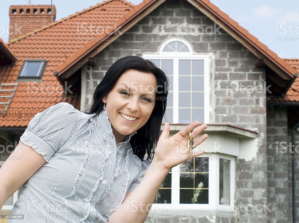 smiling woman with keys to the new house royalty-free stock photo