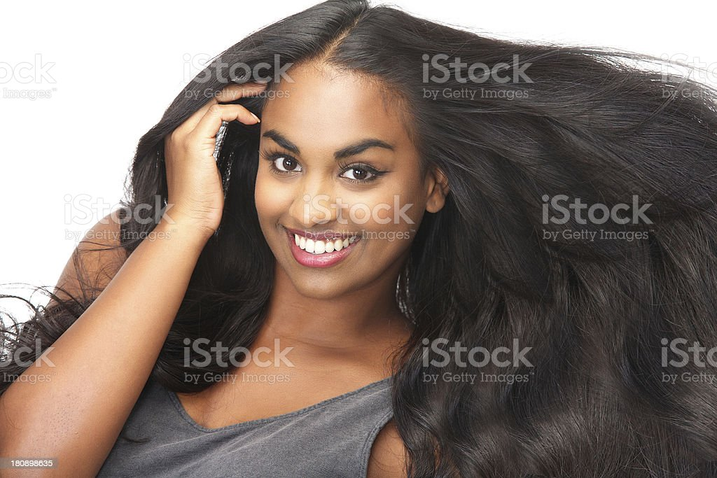 Smiling woman with long, flowing hair royalty-free stock photo