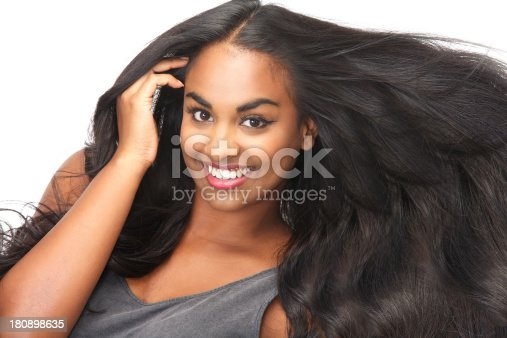 629077968istockphoto Smiling woman with long, flowing hair 180898635
