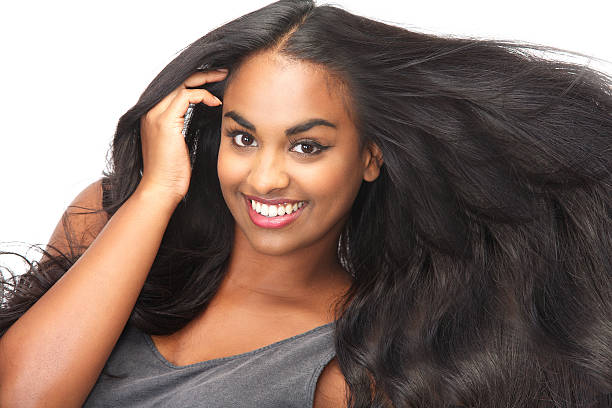 Smiling woman with long, flowing hair stock photo