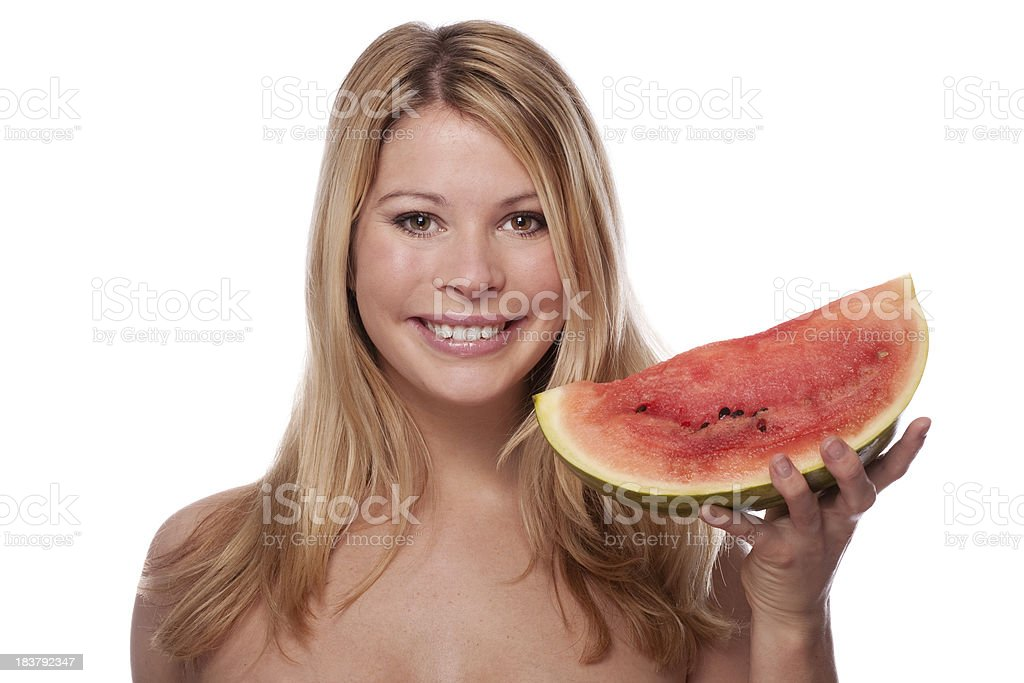 Smiling woman with melon stock photo