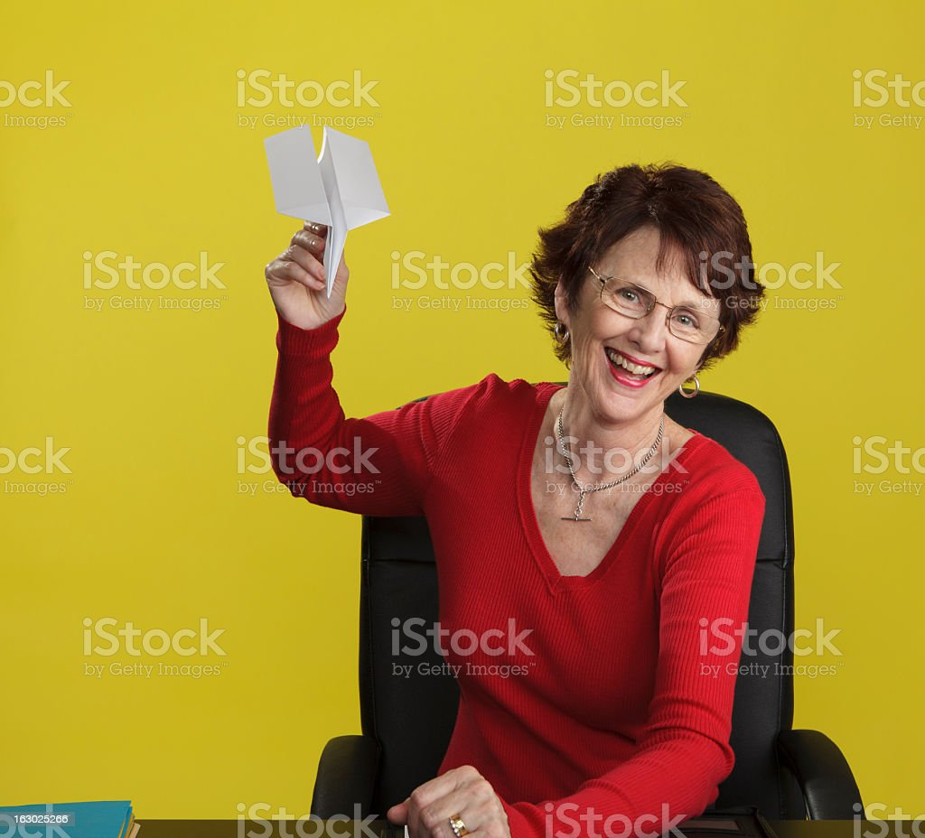 Smiling Woman with Paper Aeroplane royalty-free stock photo