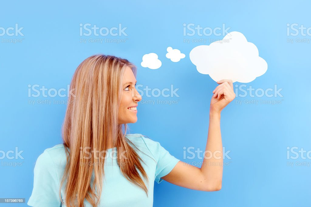 Smiling woman with paper thought clouds stock photo