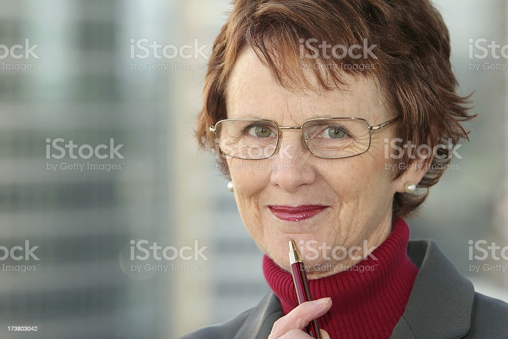 Smiling woman with pen. royalty-free stock photo
