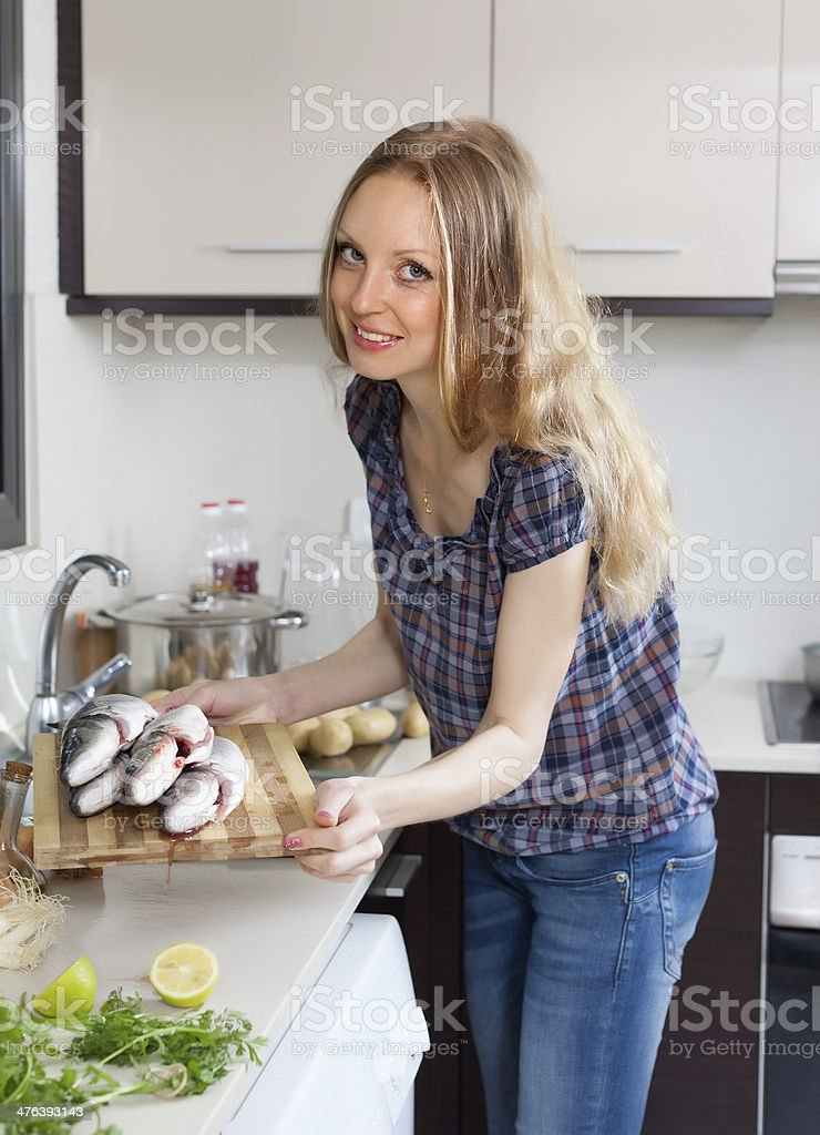 Smiling woman with raw fish royalty-free stock photo