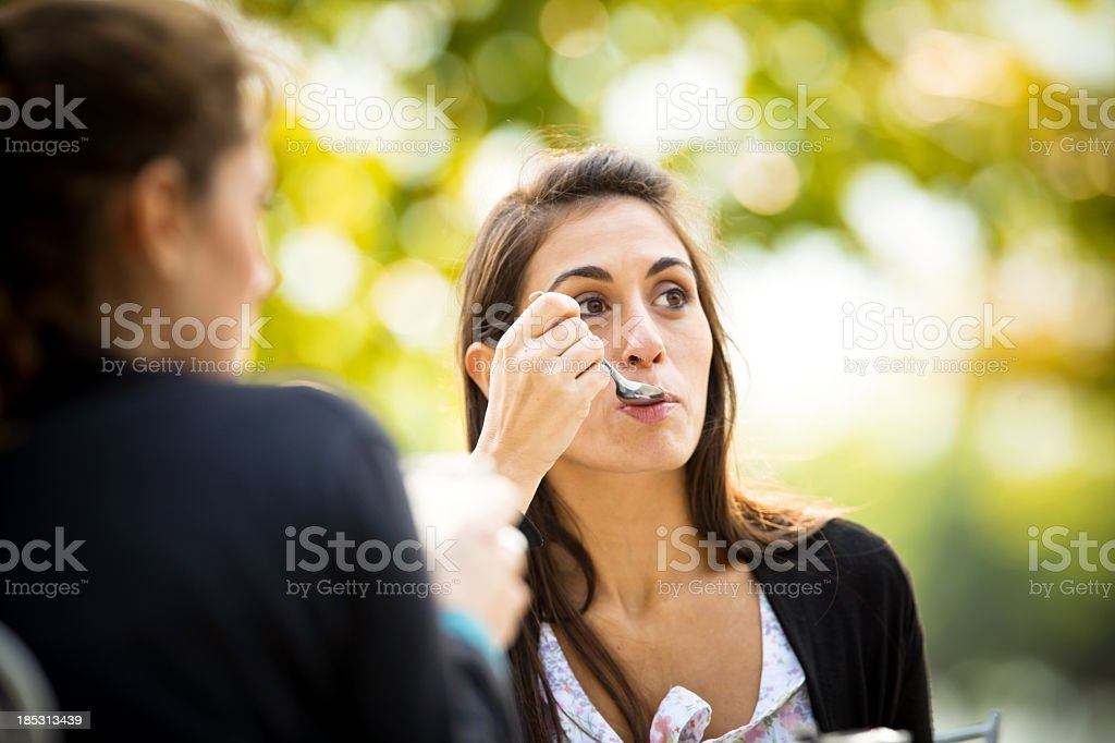 smiling woman with spoon in her mouth stock photo