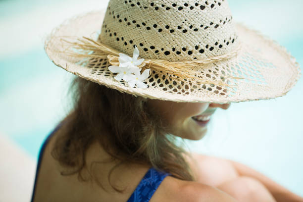 Smiling woman with straw hat stock photo