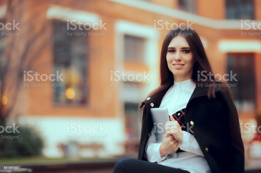 Smiling Woman with Tablet PC in University Campus stock photo