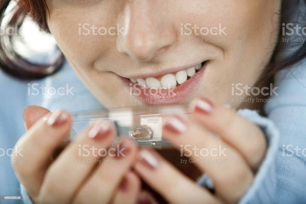 Smiling woman with tea cup royalty-free stock photo