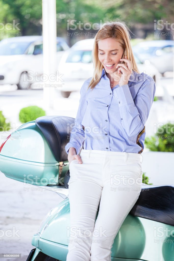 Smiling woman with telephone royalty-free stock photo