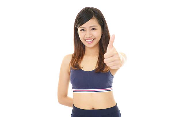 笑顔の女性、親指を立てる ストックフォト