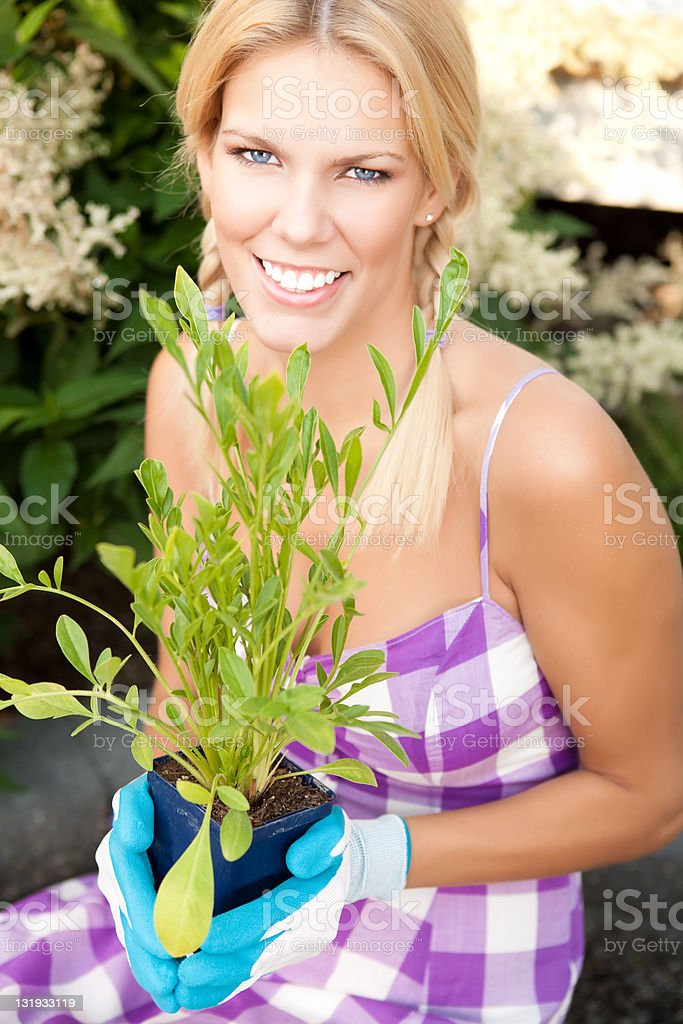 Smiling woman working in the garden royalty-free stock photo