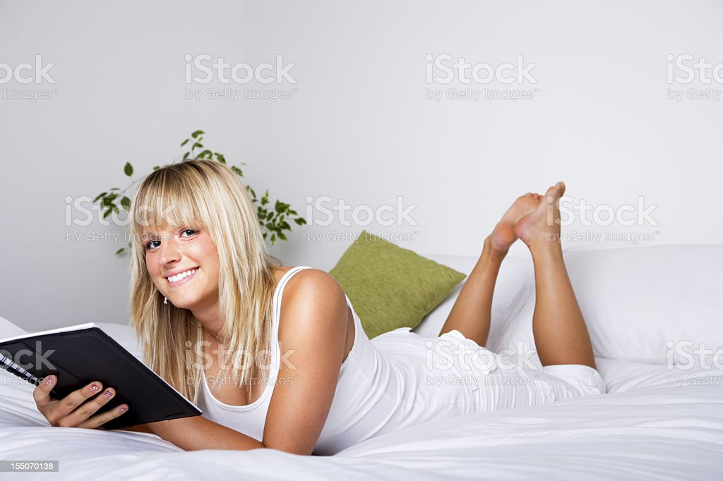 Smiling woman writing her diary royalty-free stock photo