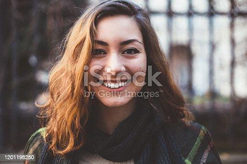 Young woman looking at camera feeling happy