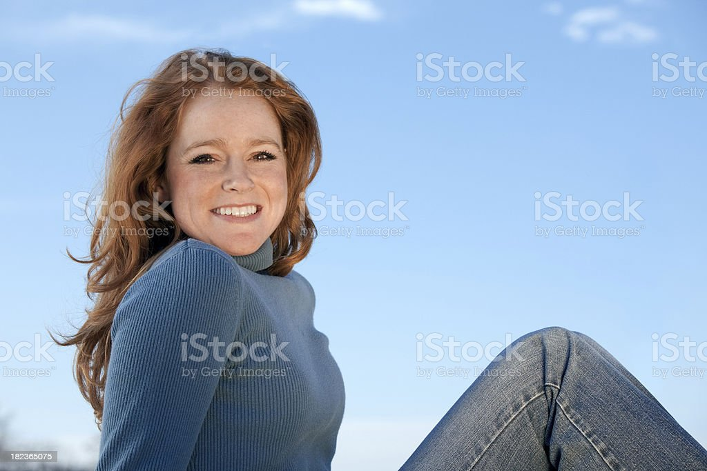 Smiling women blue background royalty-free stock photo