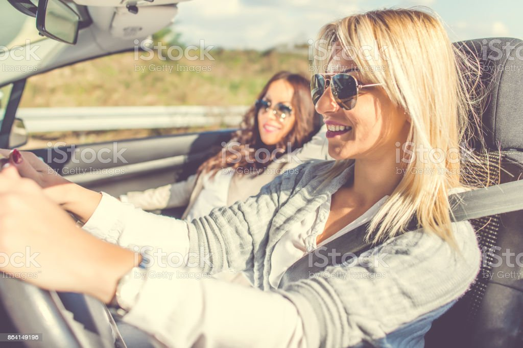 Smiling women enjoying in cabriolet royalty-free stock photo