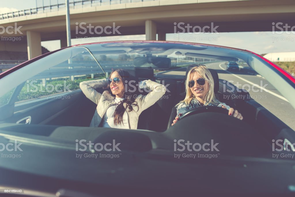 Smiling women enjoying in cabriolet royalty-free stock photo
