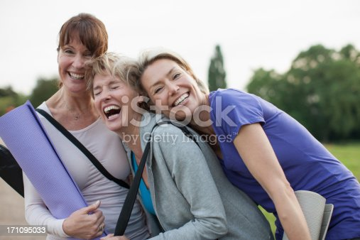 istock Smiling women holding yoga mats 171095033