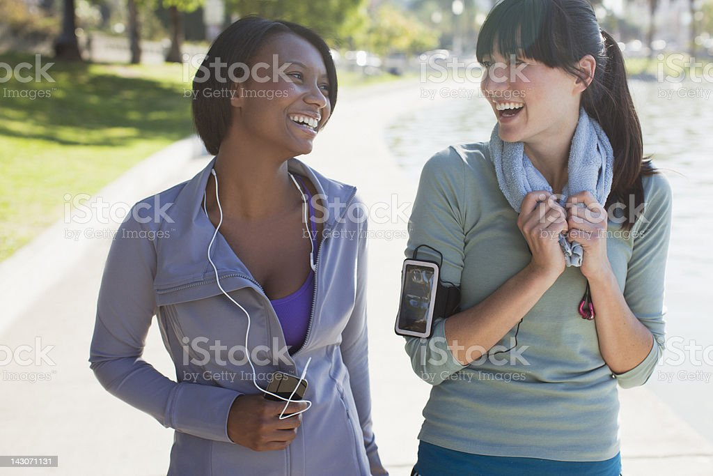 Smiling women talking after workout royalty-free stock photo