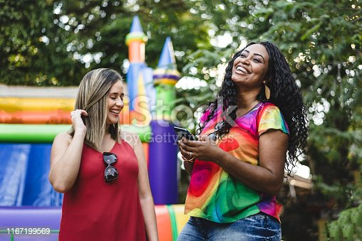 All the fun of the fair, friends having fun at the festival park.