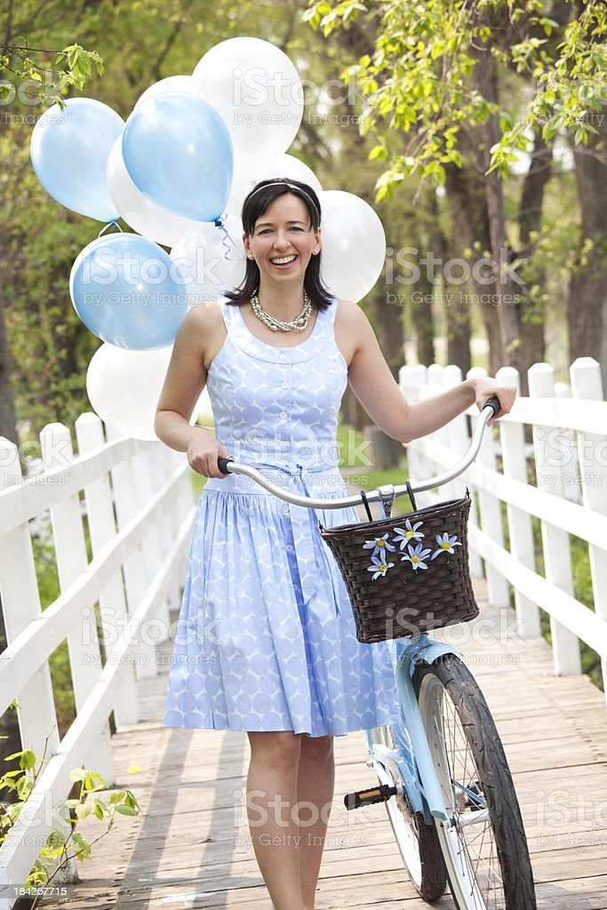 Smiling Women With Bicycle stock photo