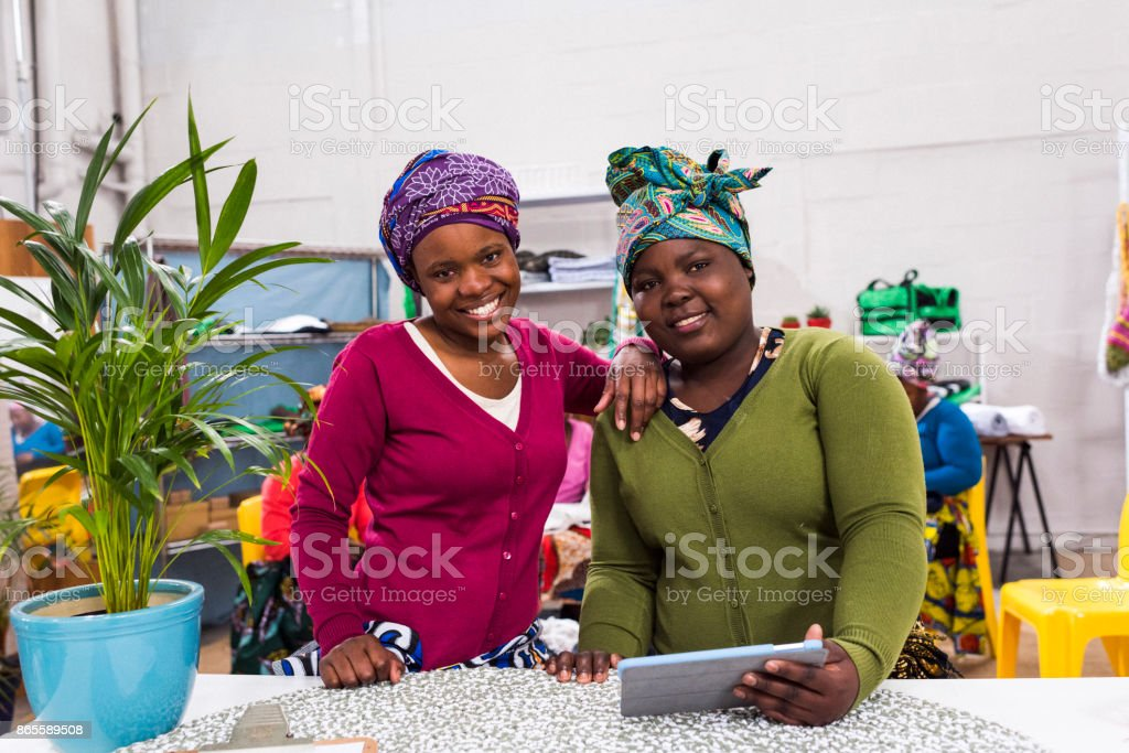 Smiling women working in their own business stock photo
