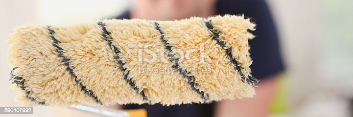 istock Smiling worker hold brush portrait 890407992