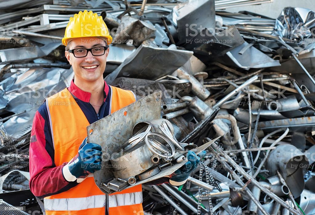 Smiling Worker in Metal Landfill stock photo