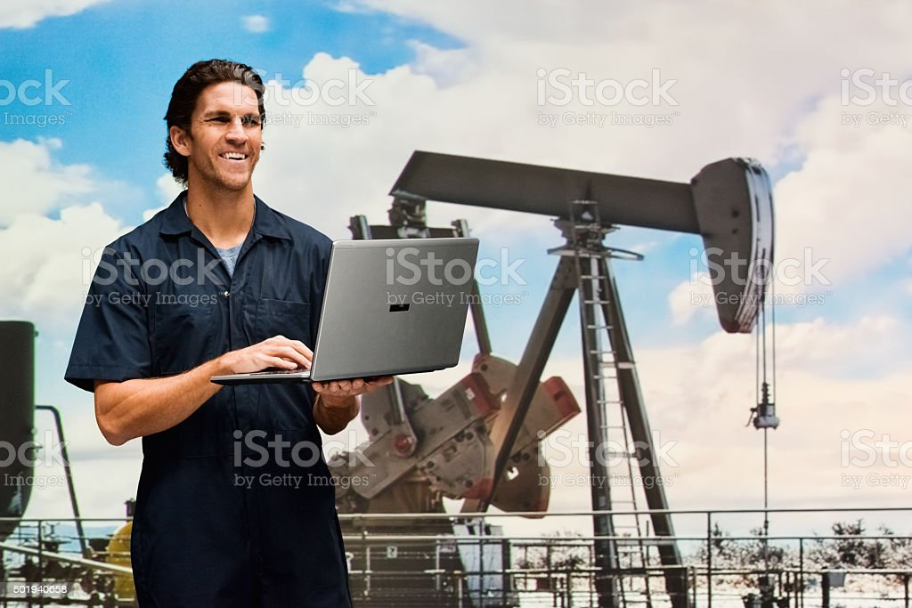 Smiling worker in oil industry stock photo