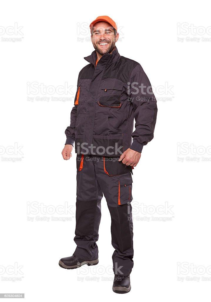 Smiling worker in uniform with orange cap stock photo