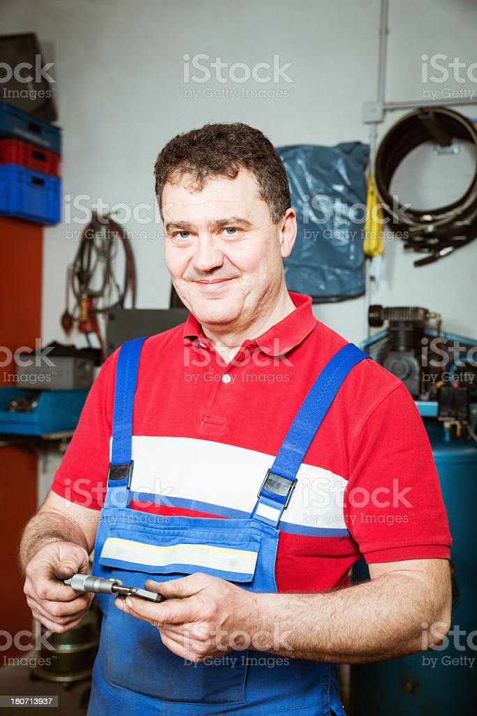 Smiling worker machinist royalty-free stock photo
