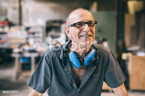 Candid portrait of factory  worker laughing