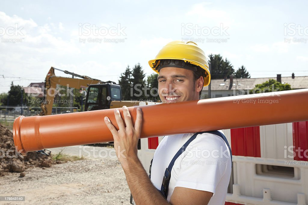 Smiling worker with a water pipe royalty-free stock photo